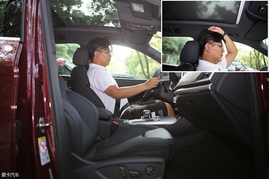 身高180cm的体验者坐进前排,将座椅调至最低且合适的坐姿后,此时头部空间剩余一拳。