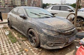 暴雨过后,被浸泡过的车子如文物出土即视感